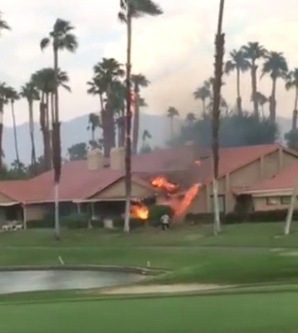 Palm tree and house burn after possible lightening strike.